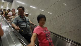 Commuters on Escalator in Shanghai