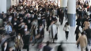 Commuters walking through Shibuya Station at rush hour, Shibuya, Tokyo, Honshu, Japan, Asia, T/Lapse