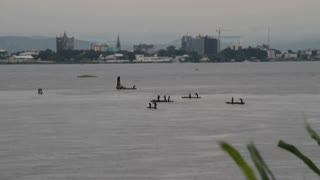 Congo River With Boats And City In The Background
