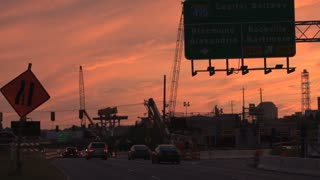 Construction on Busy Road at Sunset