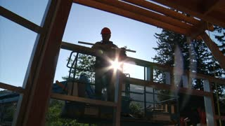 Construction Worker On Crane With Lens Flare