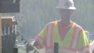 Construction Worker Riding On Machine