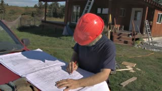 Contractor Checking Construction Plans