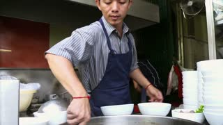 Cook preparing traditional Asian street food, man working in restaurant kitchen, Phnom Penh, Cambodia, Asia