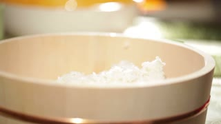 Cooking sushi. Mixing rice in wooden plate. Beautiful macro with shallow dof.