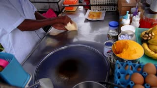 Cooking Sweet Pancakes with Banana on the Street. Traditional Thai Food. Speed up.
