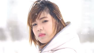 Asian woman winter portrait in snow