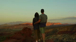 Couple Admires Sunset View In Capitol Reef National Park