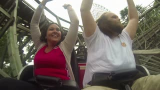 Couple Enjoying Old Roller Coaster Ride