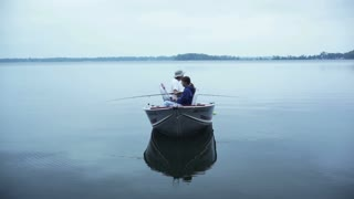 Couple Fishing in Boat