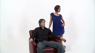Couple Flirting with Man in Chair
