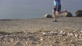 Couple jogging on the seashore, slow motion shot at 240fps