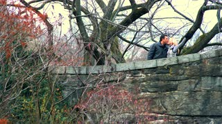 Couple Kiss on New York Bridge