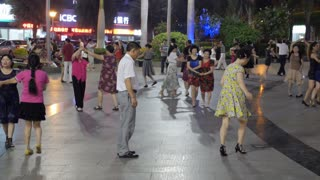 Couple Learning to Dance with Crowds in Street