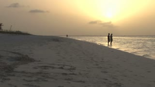 Couple on Island Beach During Sunset