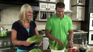 Couple Preparing a Salad in the Kitchen Dolly Shot