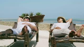 Couple resting on sunbed together