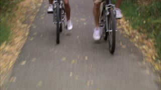 Couple Riding Bikes Through Tree Covered Path 6