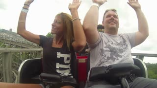 Couple Riding Front of Wooden Coaster