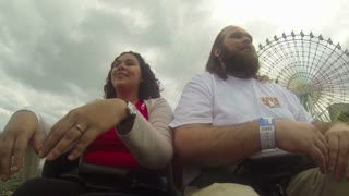 Couple Smiling Riding Roller Coaster