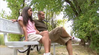 Couple Talking on a Park Bench 3