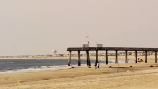 Couple Walking From Pier