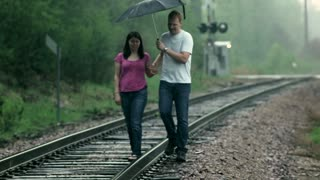 Couple Walking on Train Tracks