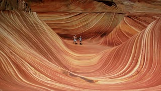 Couple Walks Through The Wave Northern Arizona