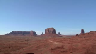 Cowboy On His Horse Looks At A Vista Of Monument Valley