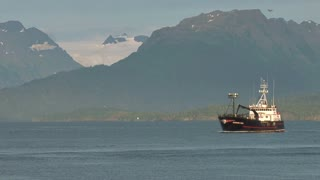 Crabbing Vessel By Mountain Range