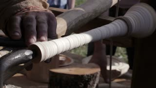 Craftsman turning wood on a manual vintage lathe