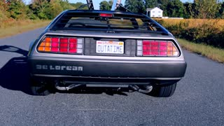 Crane Down Shot Rear View of Double Open Gull-Wing Doors on Delorean