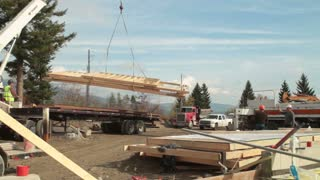 Crane Lifts Lumber From Semitruck