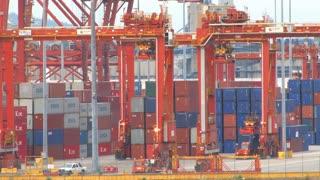 Crane Moving Crates In Shipyard