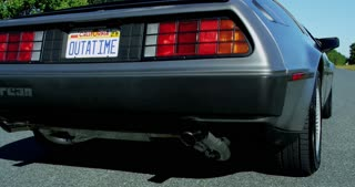 Crane Shot of Outatime License Plate to Delorean Driving Down Road 4k