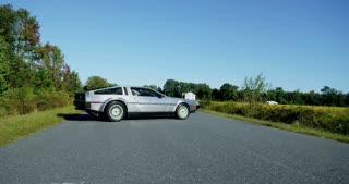 Crane Up As Delorean Turns Down Road 4K