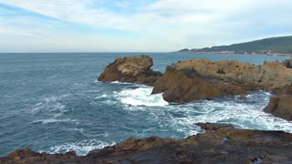 Crashing Waves On Rocky Coastline