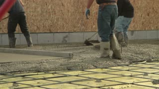 Crew Smooths Newly Poured Concrete