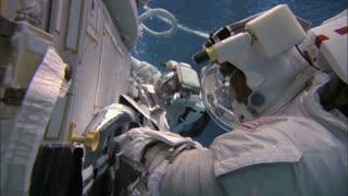Crew Underwater Trains To Make Repairs In Space
