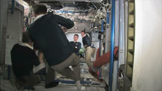 Crew Working Inside Space Station
