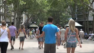 Crowd of People Under Tree Canopy in Barcelona Spain 2