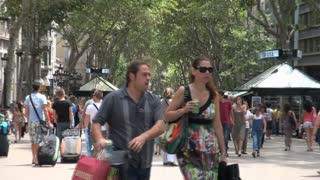 Crowd of People Under Tree Canopy in Barcelona Spain 3