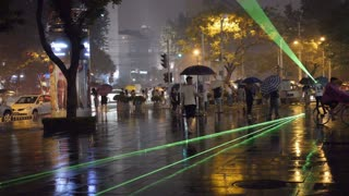 Crowd Walking Through Green Laser on Beijing Street