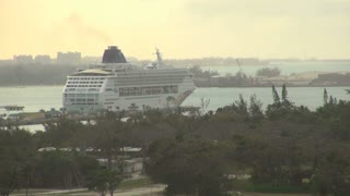 Cruis Ship Pulling Away From Island Dock