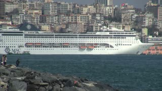 Cruise Ship Docked in Front of Istanbul Buildings
