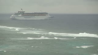 Cruise Ship Sailing Beyond Breaking Ocean Waves