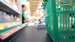Customer at Cash-desk with Cashier in Supermarket