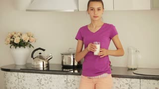 Cute girl drinking milk