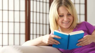 Cute girl reading  book and smiling