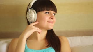 Cute girl thinking about something and listening music